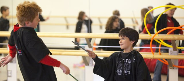 Colton Smith playfully falls backwards as he is zapped by a spell from Noah Cachiguango during a Harry Potter Dance Adventures class at the Lawrence Arts Center on Thursday, Nov. 11, 2010.