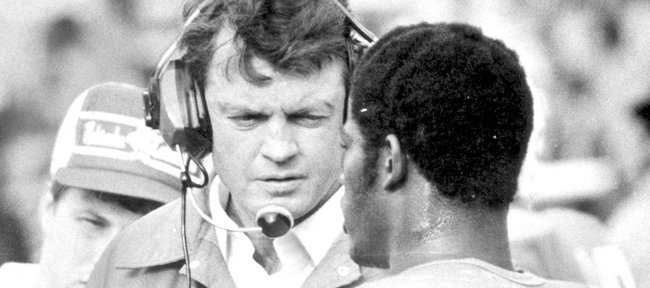 Nebraska quarterback Turner Gill, right, talks with coach Tom Osborne in this file photo from 1981. KU's Gill, who is still close with Osborne, will coach against his alma mater for the first time Saturday.