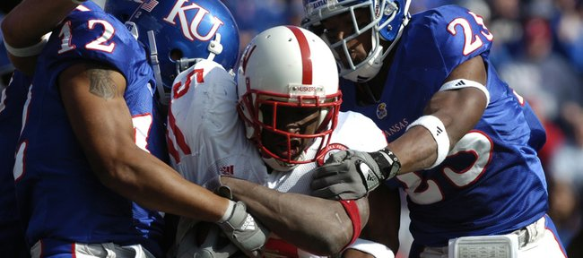 Nebraska I-back Marlon Lucky (5) gets stacked up by a host of KU defenders including James Holt, left, and Darrell Stuckey in this file photo from Nov. 3, 2007. The Jayhawks recorded a rare and historic 76-39 victory over the Huskers that day, but haven't beaten NU since.
