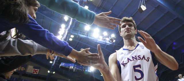Kansas center Jeff Withey slaps hands with fans as he exits the court following the Jayhawks' 113-75 win over Longwood, Friday, Nov. 12, 2010 at Allen Fieldhouse.