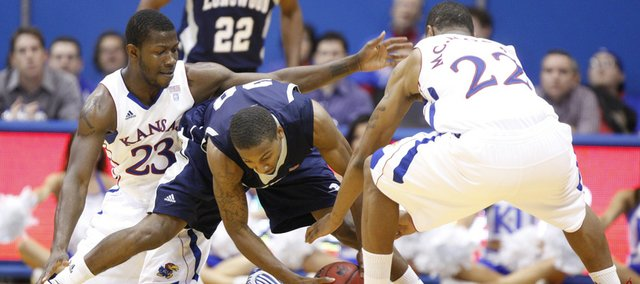 Kansas forwards Mario Little (23) and Marcus Morris (22) look to trap Longwood guard Aaron Mitchell during the second half, Friday, Nov. 12, 2010 at Allen Fieldhouse.