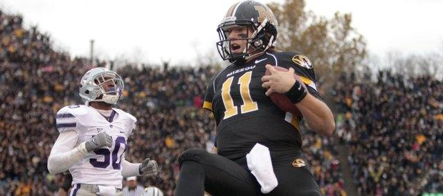 Missouri quarterback Blaine Gabbert, right, runs into the end zone past Kansas State linebacker Tre Walker, left, on a 33-yard touchdown run. Missouri beat Kansas State, 38-28, on Saturday, November 13, 2010 in Columbia, Mo.