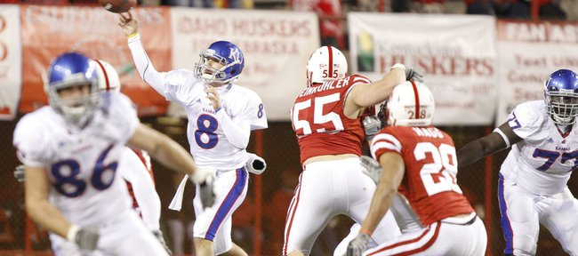 Kansas quarterback Quinn Mecham passes against the Nebraska defense during the third quarter, Saturday, Nov. 13, 2010 at Memorial Stadium in Lincoln.