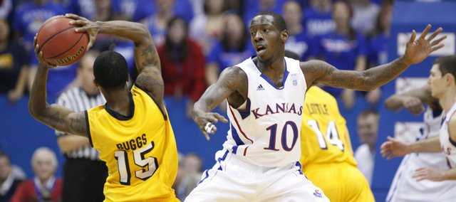 Kansas guard Tyshawn Taylor defends against a pass from Valparaiso guard Erik Buggs during the first half, Monday, Nov. 15, 2010 at Allen Fieldhouse.