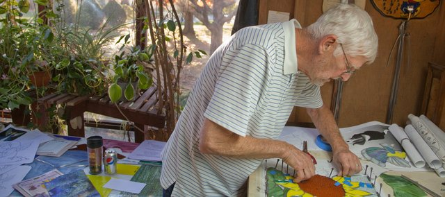 Harvey Murphy, Lawrence, works in his greenhouse studio on a stained glass sunflower piece. Murphy will display his work and be a participant in the 34th annual Holiday Bazaar on Sunday, Nov. 21, 2010.