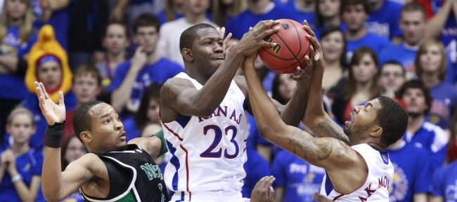Kansas forwards Mario Little (23) and Markieff Morris (21) pull a rebound away from North Texas players Kedrick Hogans, left, and Josh White during the first half Friday, Nov 19, 2010 at Allen Fieldhouse.