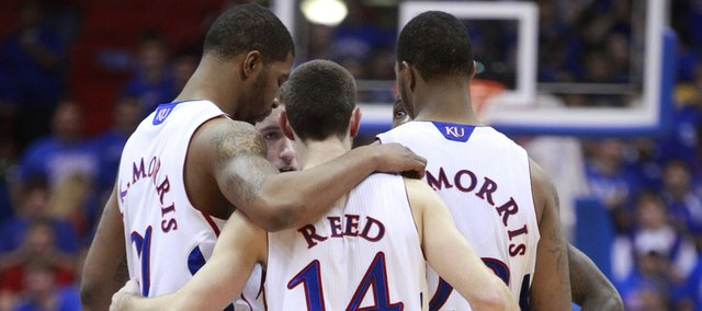 The Jayhawks come together during a timeout from action against Valparaiso in the second half, Monday, Nov. 15, 2010 at Allen Fieldhouse.