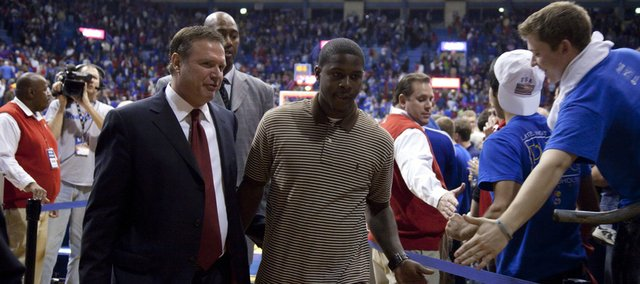 Kansas head coach Bill Self walks off the court with freshman guard Josh Selby following the Jayhawks' 93-60 win over North Texas Friday, Nov 19, 2010 at Allen Fieldhouse.