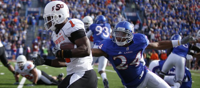Kansas safety Bradley McDougald can't keep up with Oklahoma State running back Joseph Randle as Randle heads in for a touchdown during the first quarter, Saturday, Nov. 20, 2010 at Kivisto Field.