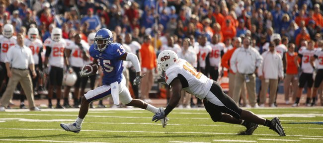Kansas receiver Daymond Patterson makes a move against Oklahoma State linebacker Shaun Lewis after a reception during the second quarter, Saturday, Nov. 20, 2010 at Kivisto F