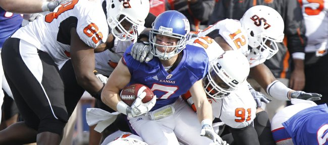 Kansas receiver Kale Pick is wrestled down by a handful of Oklahoma State defenders after a reception during the second quarter, Saturday, Nov. 20, 2010 at Kivisto Field.
