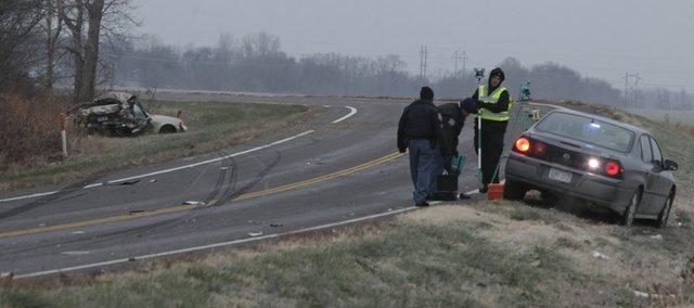 Investigators evaluate the scene of a fatality accident involving a stolen vehicle on U.S. 59 northwest of Lawrence Municipal Airport on Tuesday, Nov. 23, 2010.