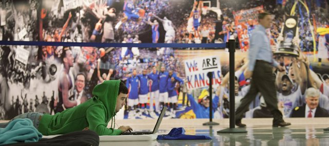 The history of KU men's basketball provides a backdrop for KU freshman Jordan Kees, Fontana, as he camps in Allen Fieldhouse to reserve a spot in line for seats for Tuesday night's Jayhawks' game against Texas A&M-Corpus Christi. A win in Tuesday's game would give KU a new record 63-game winning streak in Allen Fieldhouse.
