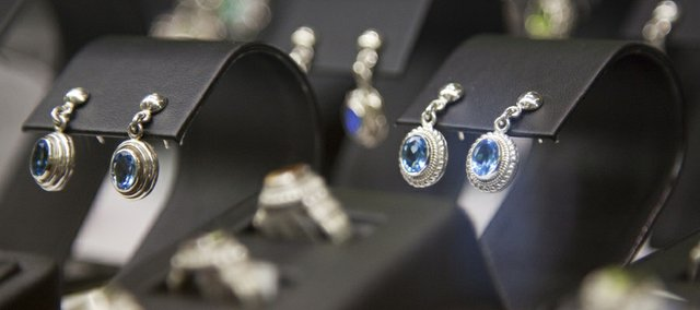 A selection of earrings and rings sits in the display case at Kizer Cummings Jewelers, 833 Mass. on Tuesday, Nov. 23, 2010.