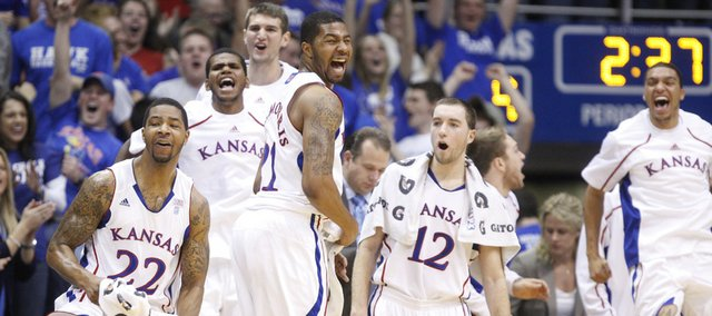 The Kansas bench erupts after a dunk by Jayhawk guard Travis Releford against Texas A&M-Corpus Christi during the first half, Tuesday, Nov. 23, 2010 at Allen Fieldhouse.
