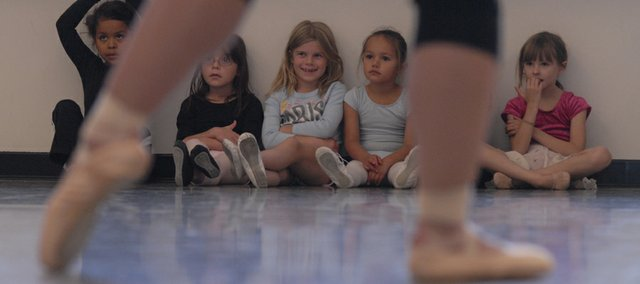 "A group of young dancers watches others perform during ""The Snow Queen"" 2007 rehearsals. This year, the show is being produced for the third time by the Lawrence Arts Center, though for the first time in three years."