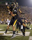 Missouri receiver Michael Egnew, left, celebrates his touchdown with teammate Wes Kemp during the Tigers' game against Colorado Saturday, Oct. 9. Egnew will be a forced to be reckoned with during the Border Showdown Saturday.