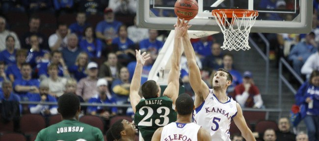 Kansas center Jeff Withey rejects a shot by Ohio forward Ivo Baltic during the first half of the Las Vegas Invitational, Friday, Nov. 26, 2010 at the Orleans Arena.