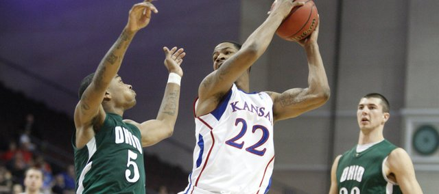 Kansas forward Marcus Morris grabs a pass in the paint between Ohio players D.J. Cooper (5) and Ivo Baltic (23) during the second half of the Las Vegas Invitational, Friday, Nov. 26, 2010 at the Orleans Arena.