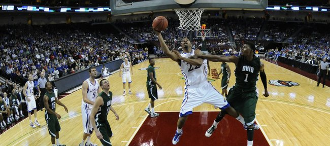 Kansas forward Marcus Morris is fouled on the shot by Ohio forward DeVa Washington during the first half of the Las Vegas Invitational, Friday, Nov. 26, 2010 at the Orleans Arena.