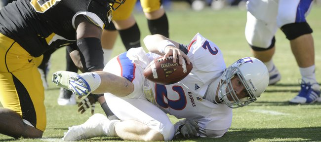 Kansas quarterback Jordan Webb (2) gets sacked for the first of several times in the first half. Kansas and Missouri met at Arrowhead Stadium Saturday for the 119th game in the rivalry series.