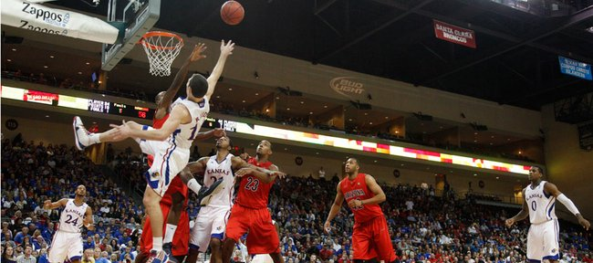 Kansas guard Tyrel Reed gets a foul on an off-balance bucket against Arizona during the second half of the Las Vegas Invitational, Saturday, Nov. 27, at the Orleans Arena.