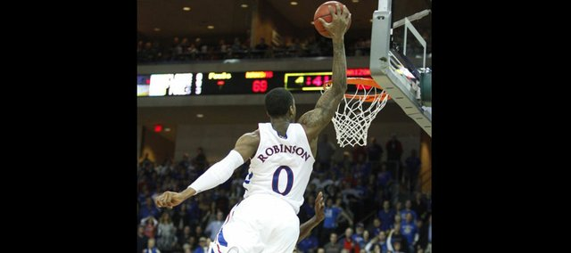 Kansas forward Thomas Robinson soars in for an alley-oop jam against Arizona during the second half of the Las Vegas Invitational, Saturday, Nov. 27, at the Orleans Arena.