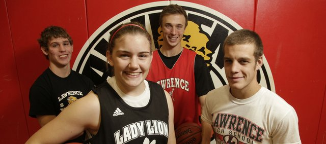 Junior Emily Peterson, front left, senior Levi Flohrschutz, front right, junior Dylan Orth, rear left, and senior Jake Johnson will look to lead Lawrence High.