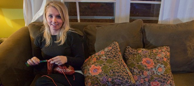 Katheryn Claypool makes handmade crocheted hats, scarves and blankets. She will be one of many artists who will have work for sale at the annual Holiday Extravaganza, which is sponsored by the Lawrence Parks and Recreation Department.