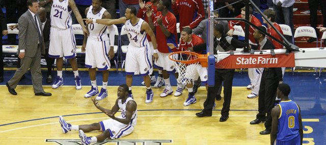 Kansas forward Mario Little and the Jayhawks' bench look for a foul after a last-second attempt by Little for a shot against UCLA during the second half, Thursday, Dec. 2, 2010 at Allen Fieldhouse. A foul was called on UCLA guard Malcolm Lee sending Little to the line in which he hit the game-winning free throw to grab a 77-76 win.