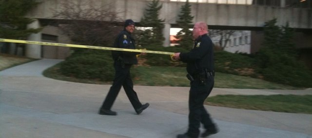 Police officers tape off Malott Hall after officials evacuated it due to a chemical spill on Monday, Dec. 6, 2010.