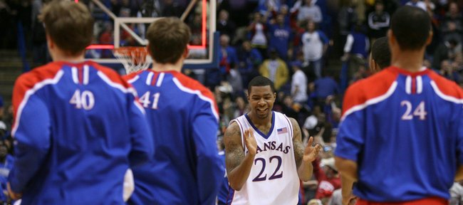 Kansas forward Marcus Morris claps his hands as the buzzer sounds on the Jayhawks' 57-55 win over Memphis, Tuesday, Nov. 17, 2009 at the Scottrade Center in St. Louis.
