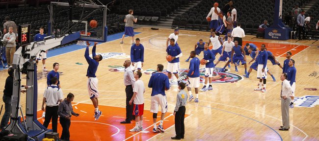 The Jayhawks warm up prior to tipping off against Memphis during the Jimmy V Classic at Madison Square Garden in New York.