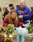 Vera Long, left, Lawrence, looks over a vendor's holiday gift items, as her daughter Olive, then 5, hugs her grandfather, Tom Ackerly, Lawrence, in this 2010 photo taken at the Holiday Farmers Market.