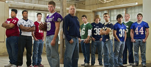 The Journal-World all-area football first team, from left, is: Jamal Brown, Lawrence High; Boomer Mays, Eudora; Brad Strauss, Lawrence High; Josh Hoffman, Baldwin; coach Doug Bennett, Veritas Christian; Dylan Perry, Free State; Kyle Brunson, Mill Valley; Nate Scott, Veritas Christian; Trent Robb, Perry-Lecompton; Justin McCandless, Free State; Dalton Hughes, Wellsville.