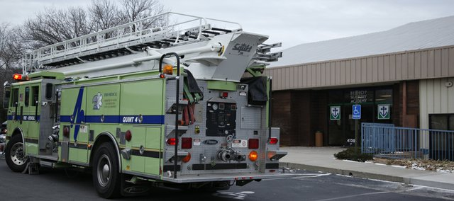 A fire truck sits outside Bishop Seabury Academy on Monday, Dec. 13, 2010 after a small fire in a utility closet filled a few classrooms with smoke.