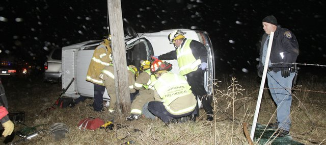 Lawrence Douglas County Fire and Medical work the scene of a two vehicle accident west of Lawrence on US Highway 40 about 6:45 p.m. Wednesday. One person was transported after being extracted from truck.