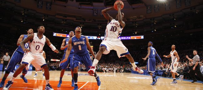Kansas guard Tyshawn Taylor looks to pass against the Memphis defense during the second half of the Jimmy V Classic Tuesday, Dec. 7, 2010 at Madison Square Garden in New York.