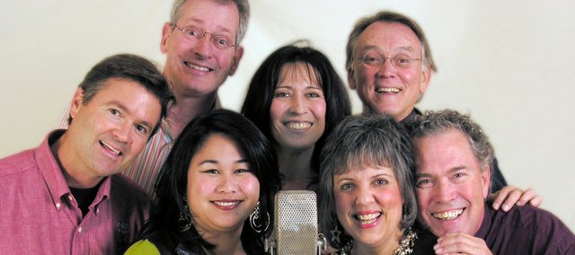 Right Between The Ears left to right : Rick Tamblyn, David Greusel, Andi Meyer, Teri Wilder, Roberta Solomon, Kip Niven, and John Jessup. The comedy troupe will perform their holiday show live this Saturday at the Kansas Public Radio Performance Studio, 1120 W. 11th St.
