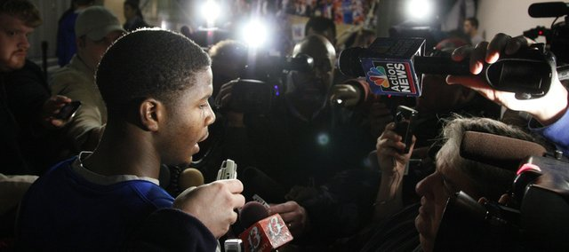 Kansas guard Josh Selby takes questions from reporters in the northeast corner of Allen Fieldhouse before practice, Thursday, Dec. 16, 2010. Selby will play his first game as a Jayhawk Saturday after serving a nine-game suspension.