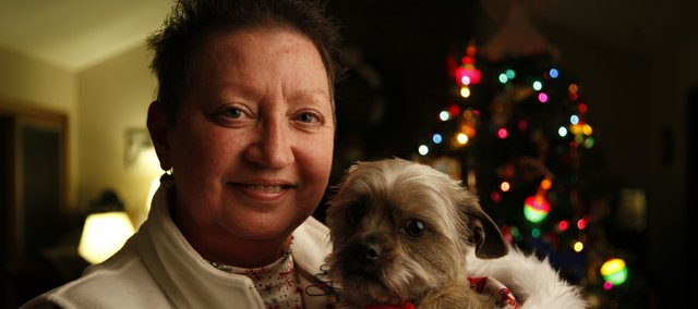 Margene Swarts and her dog Toto, a Cairn terrier mix, are pictured in their Lawrence home. Swarts says that one of Toto&#39;s favorite things to do is ride along in the car during trips.