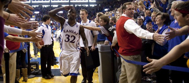 Kansas guard Josh Selby salutes the Allen Fieldhouse crowd as he leaves the court following the Jayhawks' 70-68 win over USC, Saturday, Dec. 18, 2010. Selby made his debut with 21 points and hit what proved to be the game winning shot.