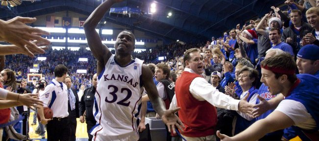 Kansas guard Josh Selby salutes the Allen Fieldhouse crowd as he leaves the court following the Jayhawks' 70-68 win over USC, Saturday, Dec. 18, 2010. Selby made his debut with 21 points and hit what proved to be the game winning shot with 24 seconds left.