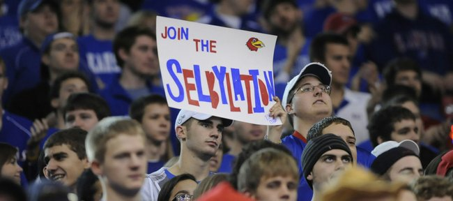 A Kansas fan shows off a sign in the Allen Fieldhouse stands as the Jayhawks faced USC on Saturday, Dec. 18, 2010.