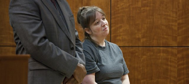 Natasha Brown, shown at her sentencing Tuesday in Douglas County District Court, has been ordered to serve a 28-month prison sentence.