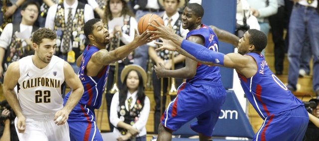 Kansas players Markieff Morris, left, Josh Selby and Thomas Robinson go after a rebound against Cal during the first half, Wednesday, Dec. 22, 2010 at Haas Pavilion in Berkeley, California. At left is Cal forward Harper Kamp.