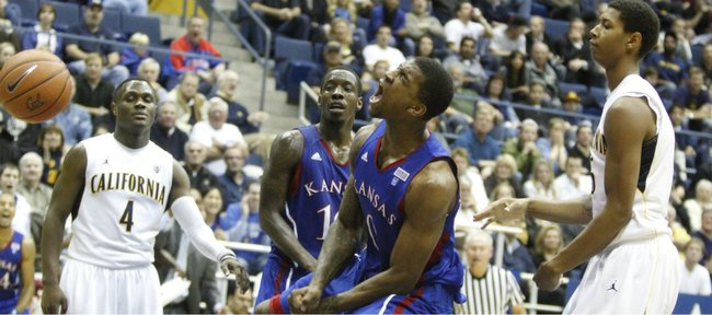 Kansas forward Thomas Robinson celebrates a dunk before Cal defenders Gary Franklin (4) and Richard Solomon (25) during the second half, Wednesday, Dec. 22, 2010 at Haas Pavilion in Berkeley, California. Also pictured is Kansas guard Tyshawn Taylor.