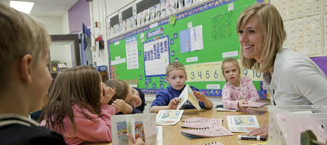 Barbie Gossett, a kindergarten teacher at Woodlawn School, works with her class during a reading exercise. From left are Luke Poloncheck, Riley Honeyman, Danny Reagan, Joe Schmidt and Abi Krise.