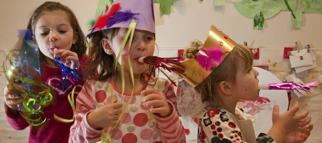 There are easy ways to get children ready for the New Year celebration with paper hats and noise makers. These three young ladies were ready for some celebration at the Lawrence Arts Center. They are, from left, Gracie Coleman, 4; Channing Morse, 3; and Vivi Riffel, 3.
