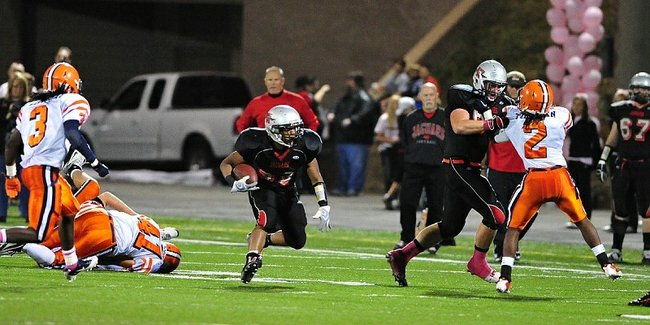 Blue Valley West offensive lineman Dylan Admire, second from right, occupies a defender and clears the way for a teammate to rumble down the field. Admire led the Jaguars with 67 pancake blocks in 2010 and will arrive at Kansas University early after graduating in late December.